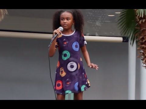 Olivia Lott, age 8,  performing 3 songs at the Music City Mall