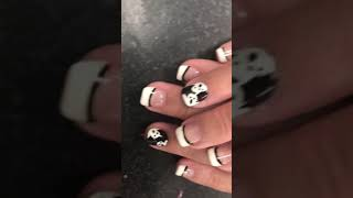 White tips, ghost designs.  black and white nails