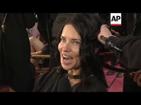 Models get ready backstage at the Victoria's Secret fashion show; Adriana Lima says she plans to go