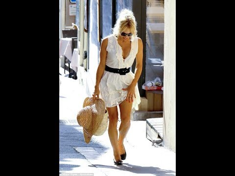 Youthful Pamela Anderson aged 50 flashes her cleavage in plunging cream summer dress thumbnail