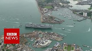 Aerial video of HMS Queen Elizabeth arriving in Portsmouth- BBC News