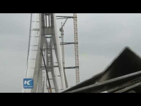 Chinese-built cable-stayed bridge completes in Africa