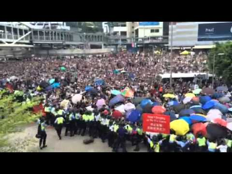 Hong Kong protesters charge police barricades