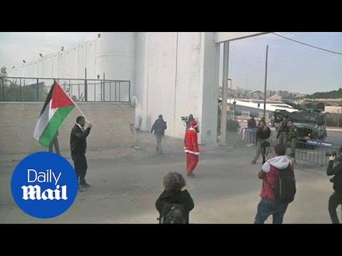 Palestinians dressed as Santa scuffle with Israeli army in Palestine - Daily Mail