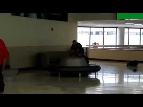 Drunk guy fights Columbus airport police *Cop pushed down!*