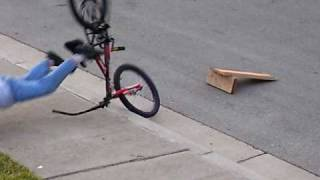 FAILED RAMP JUMP / KID CRASHES INTO SIDEWALK