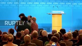 germany eritrean refugees thank merkel at cdu regional congress in jena