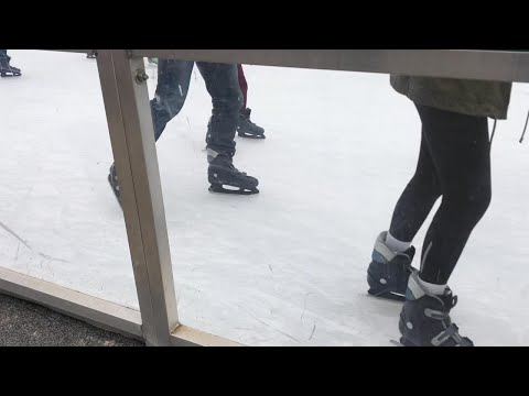Families enjoying ice skating on Market Square Friday