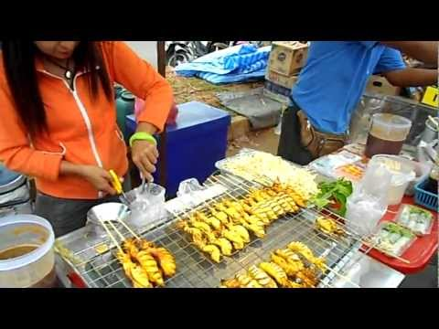 Food shopping at a market Ao Nang, Krabi, Thailand. Thai street food. Tour of a Thai food market