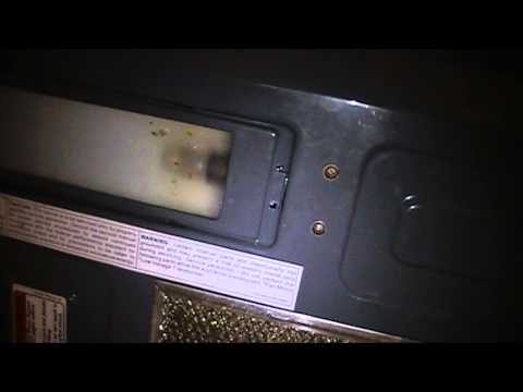 How To Change Replace Fix The Light Bulb On A Whirlpool Microwave Range You