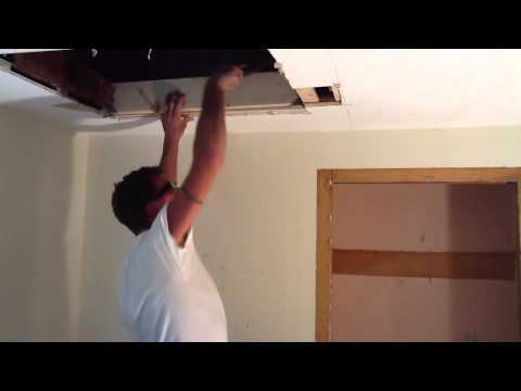 One Man Cuts In A Attic Access And Ceiling Fan Box