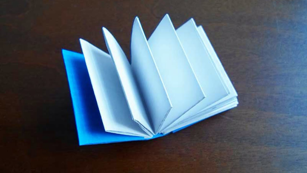Make a mini origami book crafts guidecentral youtube make a mini origami book crafts guidecentral jeuxipadfo Image collections
