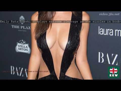 Emily Ratajkowski displays extreme cleavage as she sizzles in boob-baring cut-out dress thumbnail