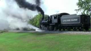 Steam Locomotive and people riding old-fashioned rail cars in South Milford