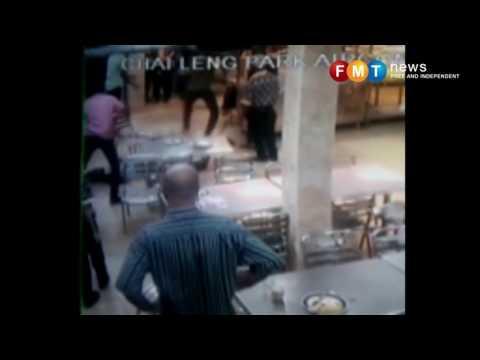 Pieces of chicken fly at nasi kandar shop during brawl