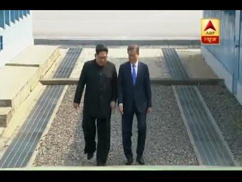 North Korea's leader Kim Jong Un meets South Korea's President Moon Jae-in warmly