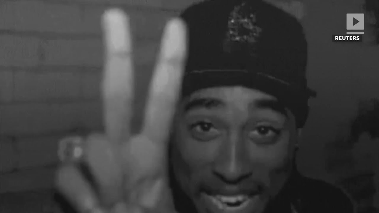 Conspiracy theorists say Tupac is 'still alive' after recent clip shows 'rapper with three young boys'