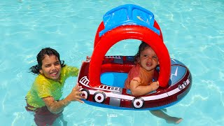 baby Amira in the pool