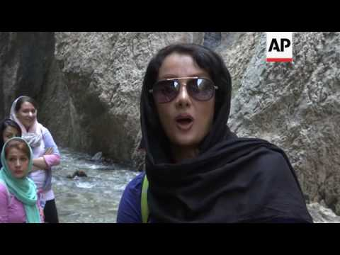 Iranians cool off in canyon near Tehran