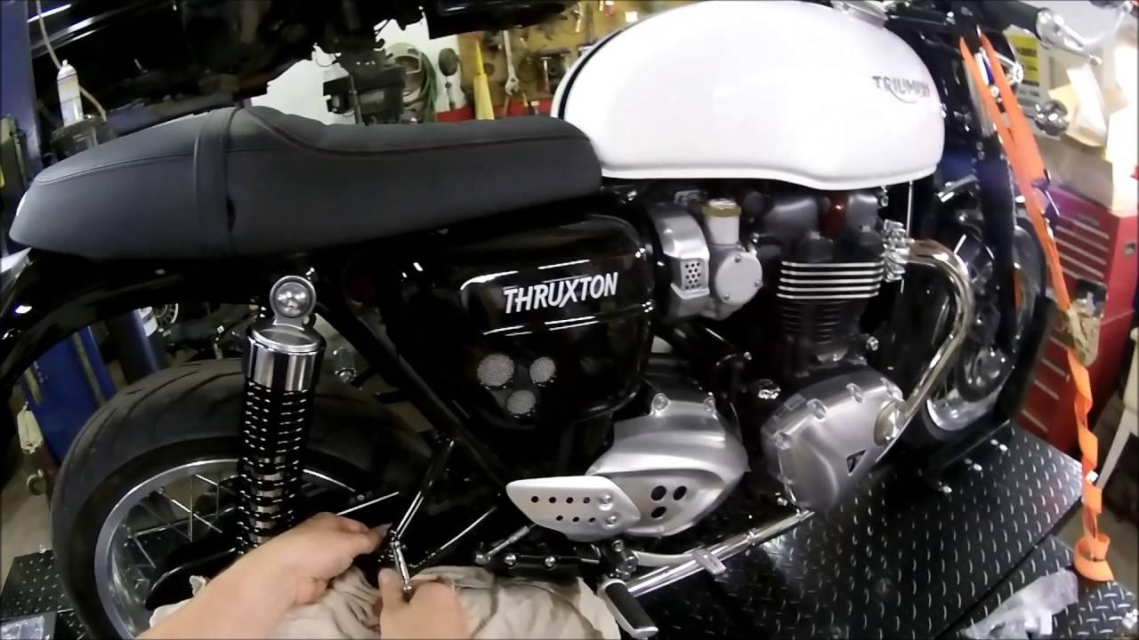 Installing Rear Footpegs On A 2016 Triumph Thruxton Youtube
