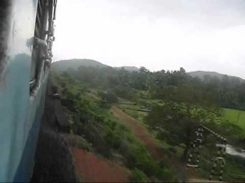 INDIAN RAILWAYS: 12619 Matsyagandha Express green landscape crossing Gangavali river, Konkan Railway