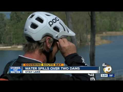 Water spills over two dams