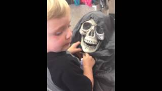 MONSTER LOVE toddler wants to cuddle with the grim reaper skeleton