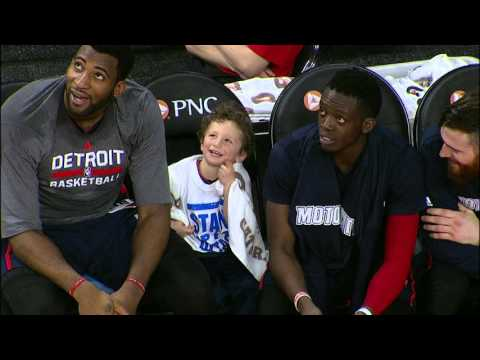Andre Drummond Sits With A Young Fan On The Bench