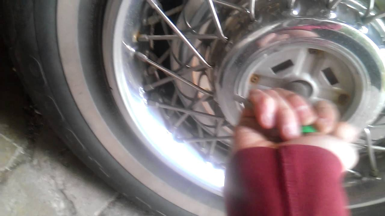 How to remove old cadillac wire hubcaps - YouTube