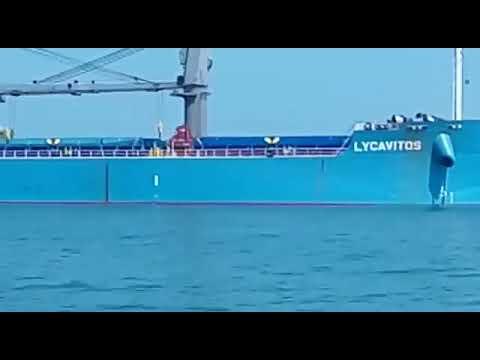 Cargo loaded vessel in middle sea.