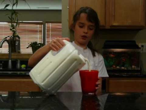 Pouring milk from square container 2.wmv