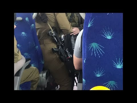 Teenagers on the bus with machine guns in Israel