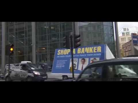 The Emperor's New Clothes - Russell Brand in New Clip - 'Shop A Banker'