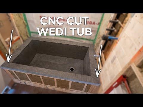 Lime plaster master bathroom remodel & CNC cut Wedi tub