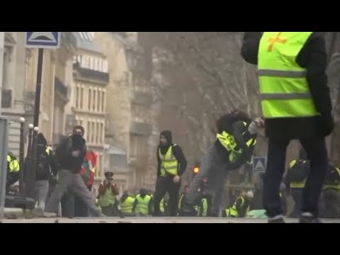 Anti-government protesters take to the streets in Paris