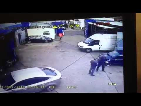 MUST WATCH!  CRAZY MOT TESTER KNOCKS DOWN WAITING CUSTOMER