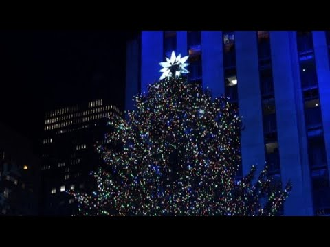 Rockefeller Christmas tree lights up in New York