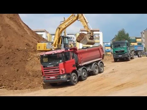 New Holland and MAN trucks and Scania in action