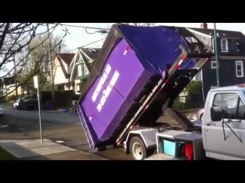 Blitz Disposal Roll off truck F450 picking up a demolition 20 yard bin