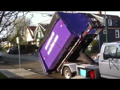 Blitz Disposal Roll Off Truck F450 Picking Up A Demolition