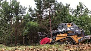 John Deere 333g with Fecon Bullhog making short work of some pine trees.