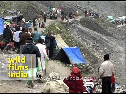 Devotees take a break during Amarnath yatra