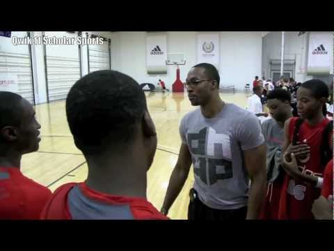 Dwight Howard is challenged by North Carolina Tar Heel Theo Pinson in Los Angeles