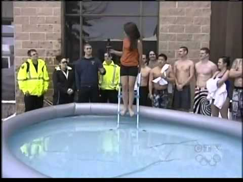 Reporter gets wet jumping a pool