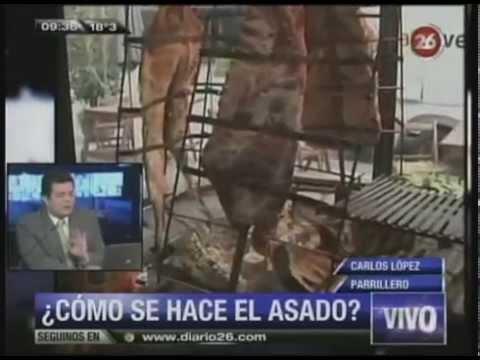 Carlos Lopez dando cátedra sobre asado en Canal 26