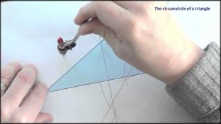 Straightedge and compass: constructing the circumcircle of a triangle