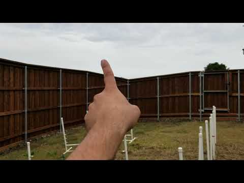 Installing a metal frame gate on a wood fence - Moore Construction Co.