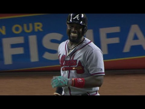 ATL@MIA: Phillips smiles at Straily after HBP
