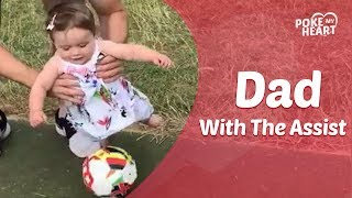 Dad Helps Baby Daughter Play Soccer