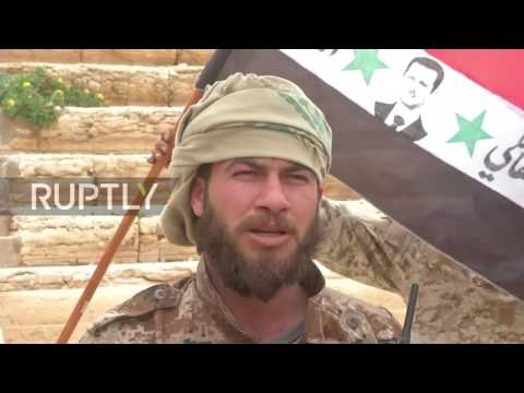 Syria: Syrian flag unfurled atop ruins of Palmyra as army pushes eastwards